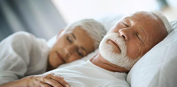 sleeping adult couple